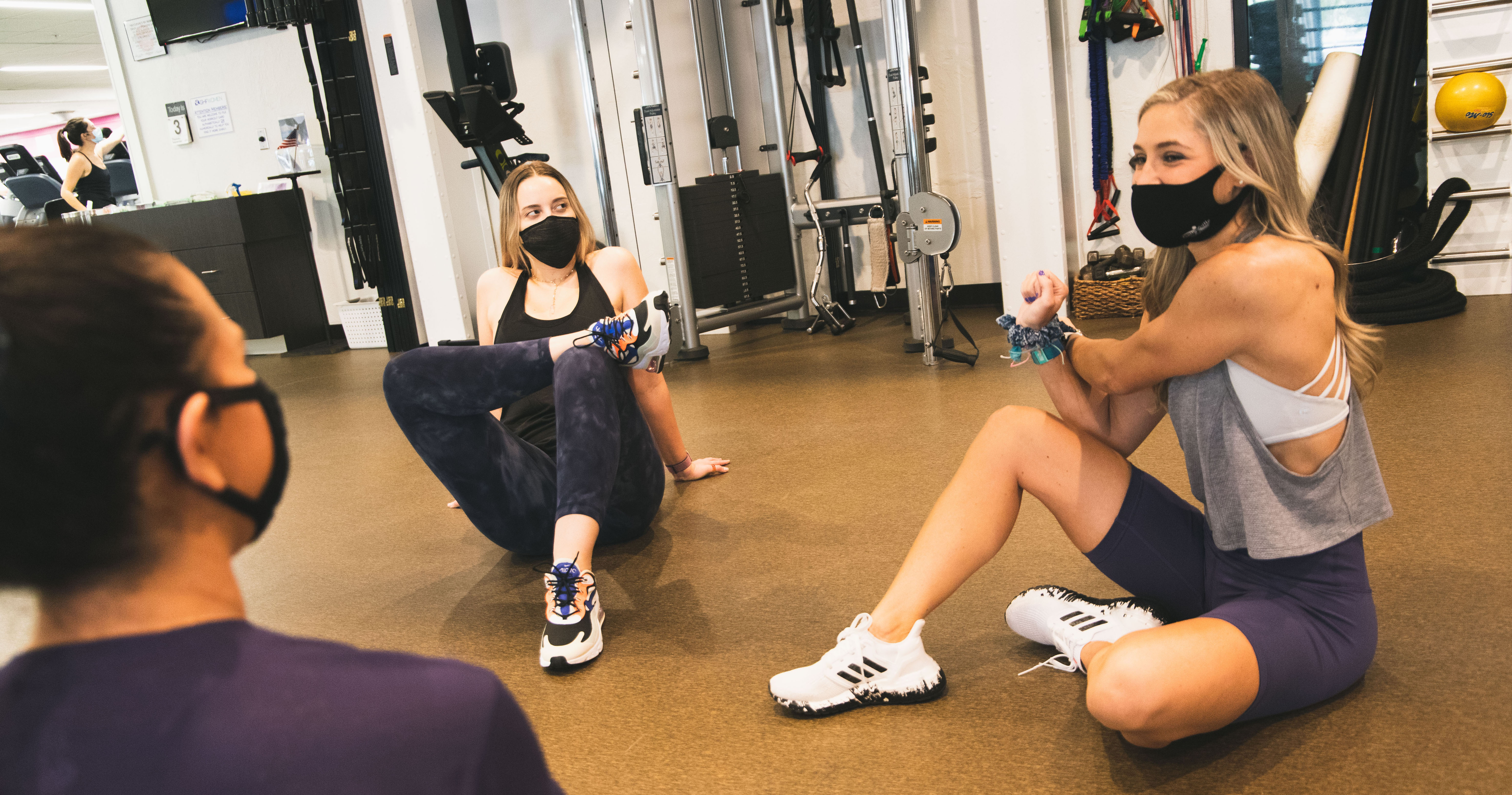 Gym members wearing masks